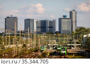 Essen city view, skyline with Postbank Tower, Evonik headquarters and RWE Tower, in front Essen West station, Essen, Ruhr area, North Rhine-Westphalia, Germany (2020 год). Редакционное фото, агентство Caro Photoagency / Фотобанк Лори