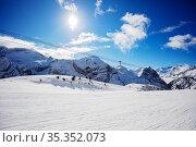 New fresh trails in ski resort over sky, skilift. Стоковое фото, фотограф Сергей Новиков / Фотобанк Лори