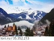 French alpine village with old church in clouds (2020 год). Стоковое фото, фотограф Сергей Новиков / Фотобанк Лори