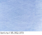 Blue Ice Rink With Snow Texture in skate scratches on an open pond. horizontal background. Стоковое фото, фотограф Мария Сибатрова / Фотобанк Лори
