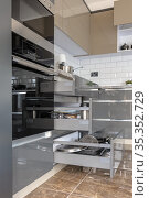 Luxury modern white, beige and grey kitchen interior. Стоковое фото, фотограф Сергей Старуш / Фотобанк Лори