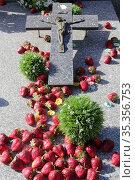 Crucifix and fake strawberries on a gravestone. Passy cemetery. Haute... Стоковое фото, фотограф Catherine Leblanc / easy Fotostock / Фотобанк Лори