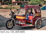 In asia philipphines the typical tuk tuk motorbike for tourist. Стоковое фото, фотограф Zoonar.com/LKPRO / easy Fotostock / Фотобанк Лори