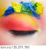 Close-up macro shot of closed teenager female eye with unusual art make-up and face painting on brows and around eye. Стоковое фото, фотограф Serg Zastavkin / Фотобанк Лори