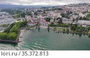 Picturesque view of Lausanne city on shore of Lake Geneva on background of mountains on summer day, Switzerland. Стоковое видео, видеограф Яков Филимонов / Фотобанк Лори