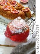 Orange pie with fruit tea on gray background. Стоковое фото, фотограф Марина Володько / Фотобанк Лори