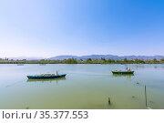 Calm lake with two fishing boats. Fresh water lagoon in Estany de... Стоковое фото, фотограф Zoonar.com/Ivan Sanchez / easy Fotostock / Фотобанк Лори