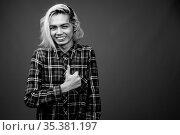 Studio shot of young Filipino man wearing stylish clothes against... Стоковое фото, фотограф Zoonar.com/Toni Rantala / easy Fotostock / Фотобанк Лори