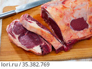 close up of pieces of marbled beef on wooden table. Стоковое фото, фотограф Яков Филимонов / Фотобанк Лори