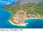 Igrane village on Makarska riviera and Biokovo mountain aerial view... Стоковое фото, фотограф Zoonar.com/Dalibor Brlek / easy Fotostock / Фотобанк Лори