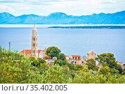 Igrane village on Makarska riviera church tower and waterfront view... Стоковое фото, фотограф Zoonar.com/Dalibor Brlek / easy Fotostock / Фотобанк Лори