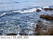 Sea waves in the area of rocky coastline close up. Стоковое фото, фотограф Евгений Харитонов / Фотобанк Лори