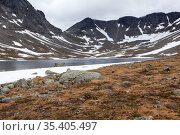 Lake with water from melted snow and ice in highlands of the Khibiny mountains. The Kola Peninsula, Russia. Стоковое фото, фотограф Кекяляйнен Андрей / Фотобанк Лори