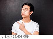Close-up portrait of jealous and gloomy asian young man feel regret... Стоковое фото, фотограф Zoonar.com/Seva Levitsky / easy Fotostock / Фотобанк Лори