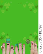 Multiple fingers decorated with st patrick's themed pictograms and clovers on green background. Стоковое фото, агентство Wavebreak Media / Фотобанк Лори
