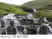Waterfall in the village of Böur, Faroe Islands. Стоковое фото, фотограф Andre Maslennikov / age Fotostock / Фотобанк Лори