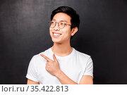 Close-up portrait of pleased dreamy cute asian guy in glasses spot... Стоковое фото, фотограф Zoonar.com/Seva Levitsky / easy Fotostock / Фотобанк Лори