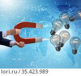 Businessman catching light bulbs on horseshoe magnet. Стоковое фото, фотограф Elnur / Фотобанк Лори