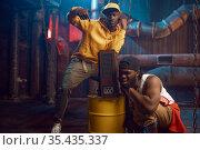 Young rappers, break-dance performing in studio. Стоковое фото, фотограф Tryapitsyn Sergiy / Фотобанк Лори