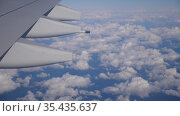 View from passenger window of wing of airplane flying in sky on sunny day. Concept of successful travel. Стоковое видео, видеограф Яков Филимонов / Фотобанк Лори