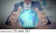 Digital composite image of mid section of businessman holding globe. Стоковое фото, агентство Wavebreak Media / Фотобанк Лори