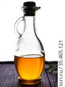 Glass bottles with olive oil on a dark background. Стоковое фото, фотограф Анна Гучек / Фотобанк Лори