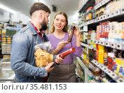 Portrait of couple choosing products. Стоковое фото, фотограф Яков Филимонов / Фотобанк Лори