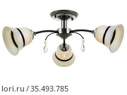 Black three-lamp ceiling lamp with chrome base and matt white bell-shaped shades with a black transverse stripe. Isolated on white background. Стоковое фото, фотограф Вадим Орлов / Фотобанк Лори