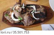 Delicious grilled beef steak and cooked French fries. Стоковое видео, видеограф Яков Филимонов / Фотобанк Лори