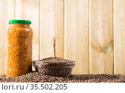 Canned and dry lentils on wooden background. Стоковое фото, фотограф Яков Филимонов / Фотобанк Лори