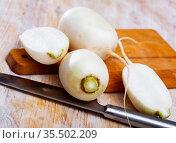 Raw white turnip cut on wooden background, nobody. Стоковое фото, фотограф Яков Филимонов / Фотобанк Лори