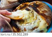 Camembert fondue in bread bowl. Стоковое фото, фотограф Яков Филимонов / Фотобанк Лори