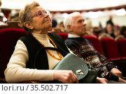 Elderly couple man and woman enjoying performance at opera and ballet theater. Стоковое фото, фотограф Татьяна Яцевич / Фотобанк Лори