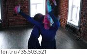 Ballet dancing - two little girls dancing in in a dance studio in dresses - neon lighting. Стоковое видео, видеограф Константин Шишкин / Фотобанк Лори