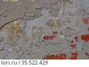 Old wall for texture or background, rough aged surface, remnants of peeling plaster, multi-colored grunge-style. Стоковое фото, фотограф Андрей Копылов / Фотобанк Лори