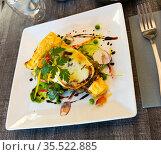 Delicious french vegetable pie with mozzarella di bufala cheese. French dish. Gascony cuisine. Стоковое фото, фотограф Яков Филимонов / Фотобанк Лори