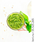 Pesto sauce in a glass jar, basil, pine nuts, garlic and olive oil... Стоковое фото, фотограф Zoonar.com/kostrez / easy Fotostock / Фотобанк Лори