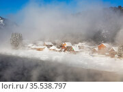 View of the village of Artybash through heavy fog over the Biya River in winter. Altai Republic, Russia (2020 год). Стоковое фото, фотограф Наталья Волкова / Фотобанк Лори