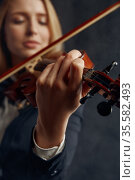 Female violonist with bow and violin, solo concert. Стоковое фото, фотограф Tryapitsyn Sergiy / Фотобанк Лори