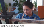 A chubby indpired woman paint artist drawing a painting with a brush. Стоковое видео, видеограф Константин Шишкин / Фотобанк Лори