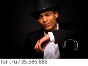 Magic, performance, circus, show concepts. Magician man in top hat... Стоковое фото, фотограф Zoonar.com/Svyatoslav Lypynskyy / age Fotostock / Фотобанк Лори