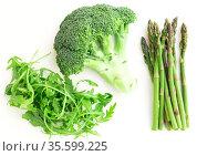 green farm vegetables, arugula, broccoli, asparagus on white background. Стоковое фото, фотограф Татьяна Яцевич / Фотобанк Лори