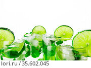 Mojito cocktails with lime and mint isolated on white background. Стоковое фото, фотограф Zoonar.com/Ivan Mikhaylov / easy Fotostock / Фотобанк Лори