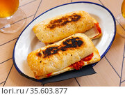 Hot homemade sandwich with chorizo and cheese. Стоковое фото, фотограф Яков Филимонов / Фотобанк Лори