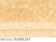 Shiny golden bokeh glitter lights abstract background, Christmas New... Стоковое фото, фотограф Zoonar.com/Ivan Mikhaylov / easy Fotostock / Фотобанк Лори