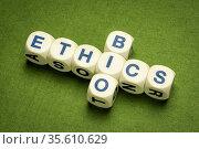 Bioethics crossword in dice letters against green handmade paper,... Стоковое фото, фотограф Zoonar.com/Marek Uliasz / easy Fotostock / Фотобанк Лори