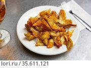 Plate of tasty roasted artichokes closeup. Spanish dish. Стоковое фото, фотограф Яков Филимонов / Фотобанк Лори