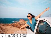 Young woman on vacation travel by car. Стоковое фото, фотограф Дмитрий Травников / Фотобанк Лори