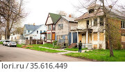 Detroit Michigan boarded up abandoned houses dominate the landscape... Стоковое фото, фотограф Zoonar.com/Christopher Boswell / easy Fotostock / Фотобанк Лори