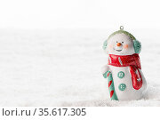 Christmas Snowman toy on winter background in the snow. Стоковое фото, фотограф Zoonar.com/Ivan Mikhaylov / easy Fotostock / Фотобанк Лори